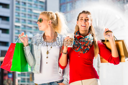 women shopping in the city with