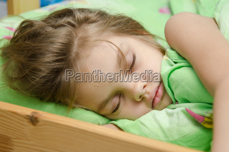 portrait of young girl sleeping in
