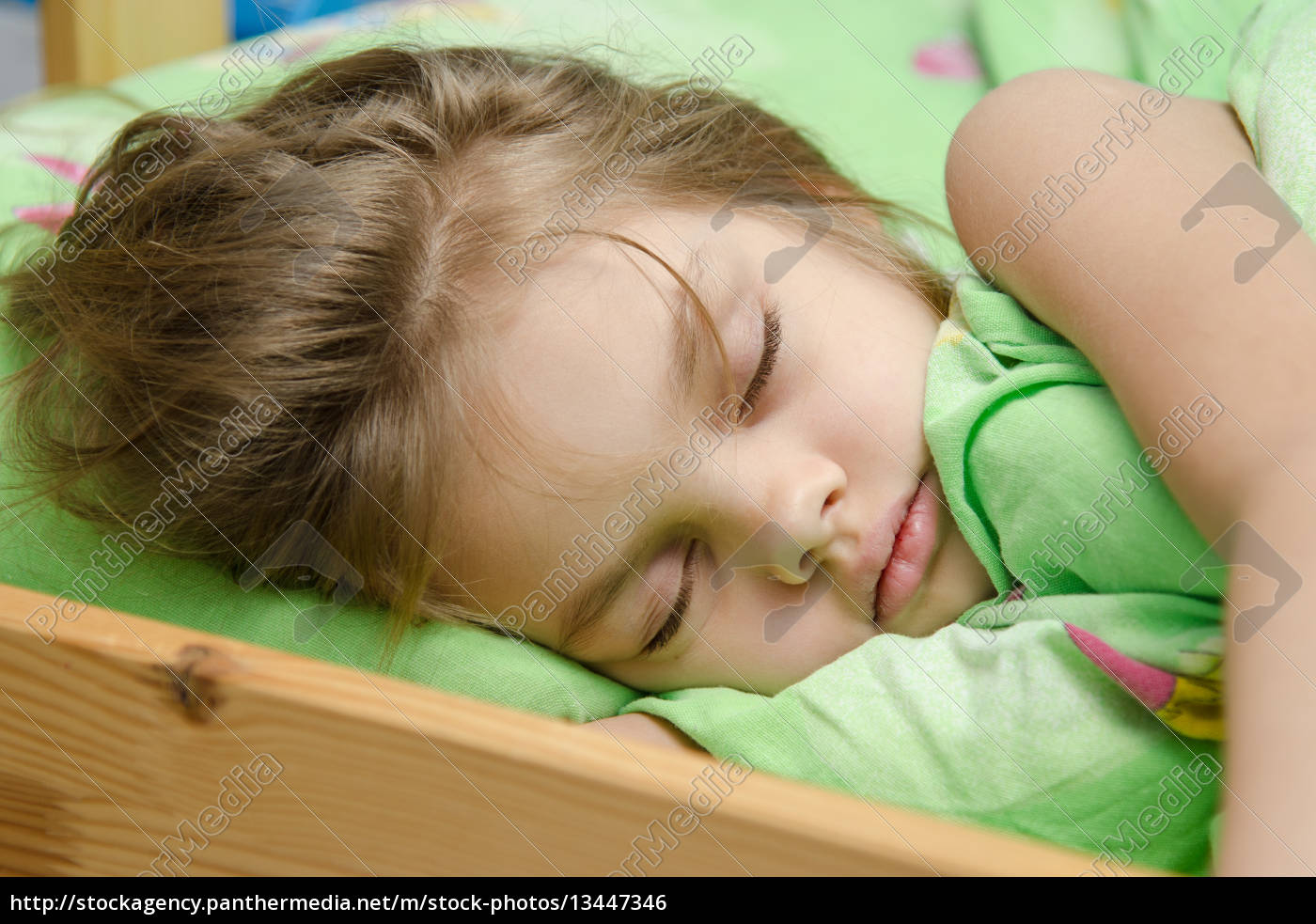 portrait, of, young, girl, sleeping, in - 13447346