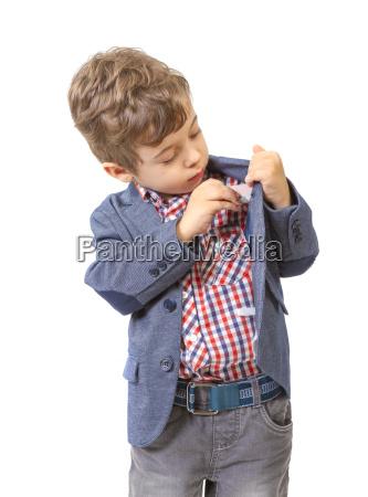 little boy puts money in his