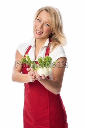 blonde housewife presented fennel bulbs