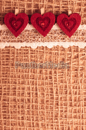 red, hearts, on, abstract, cloth, background - 13460452