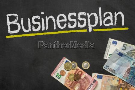 blackboard with money business plan