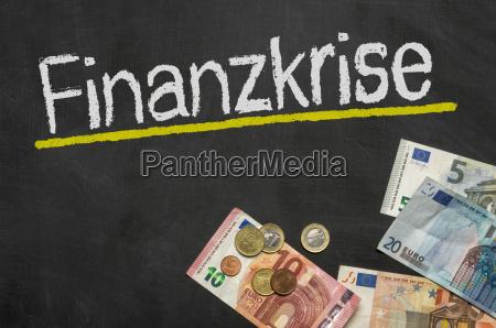 blackboard with money financial crisis