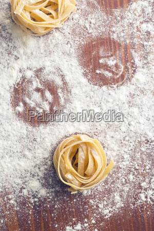 raw pasta and flour