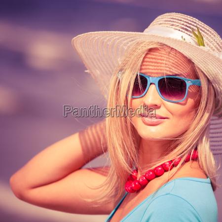 beautiful blonde girl in hat on