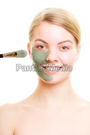 skin care woman applying clay mud