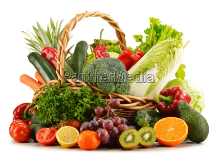 wicker basket with groceries isolated on