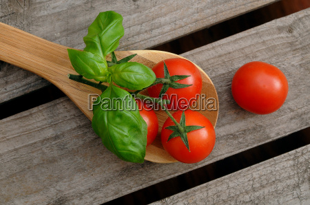 tomatoes on a cooking spoon
