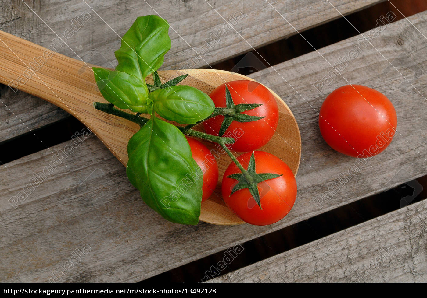 tomatoes, on, a, cooking, spoon - 13492128