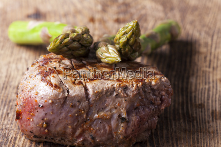 juicy steak grilled with asparagus