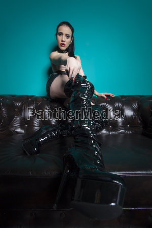 domination in leather on a couch