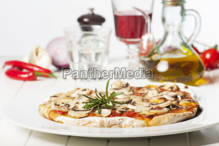 italian pizza funghi on a white