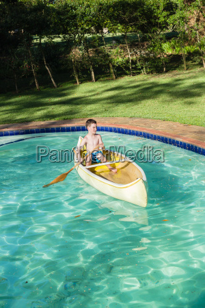 boy canoe pool