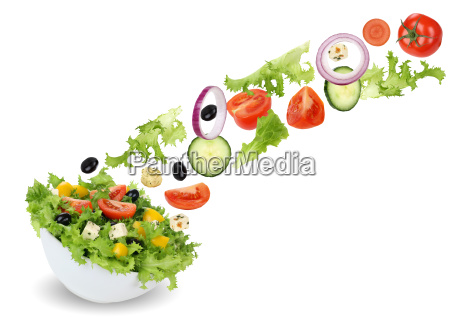 flying salad in bowl with tomato