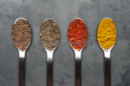 spoon with spices on a slate
