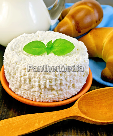 curd with milk and spoon on