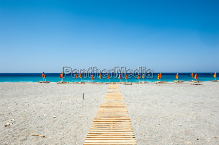 beach with umbrellas and sun loungers