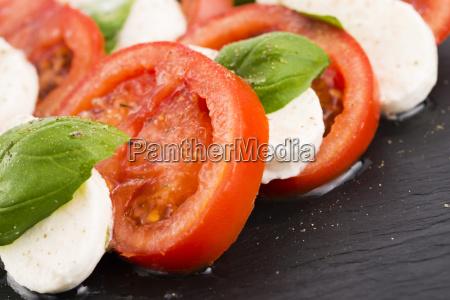 caprese salad with mozzarella tomato basil