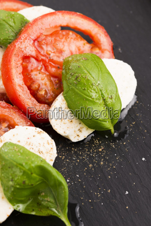 caprese salad with mozzarella tomato basil