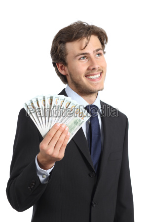 happy businessman holding money and looking