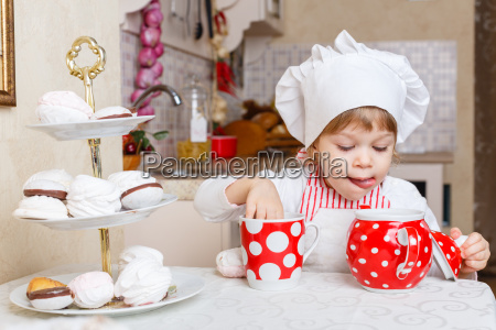 little girl in apron in the