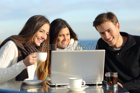 group of friends watching a laptop
