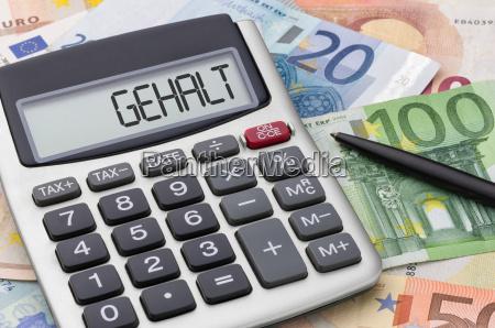 calculator, with, money, bills, -, salary - 13518524