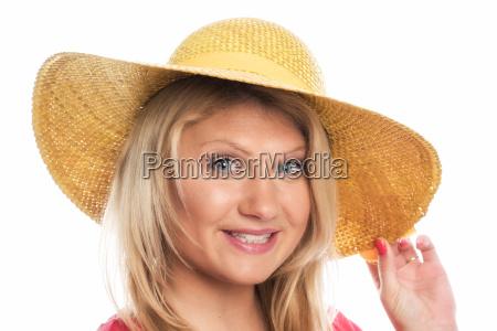 blonde with straw hat in portrait