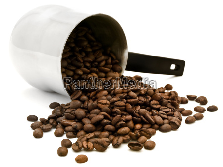 turkish percolator with scattered coffee beans