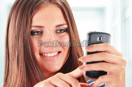 young woman using smartphone isolated on