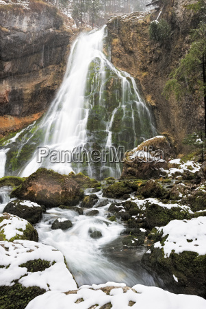 gollinger waterfalls at wintertime austria