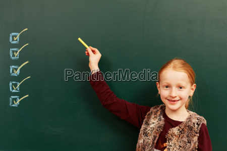 girl points to the list on