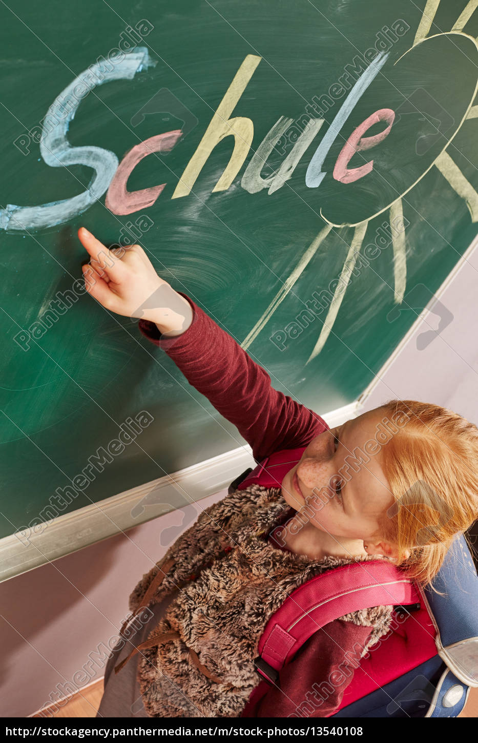 girl, pointing, to, the, blackboard - 13540108