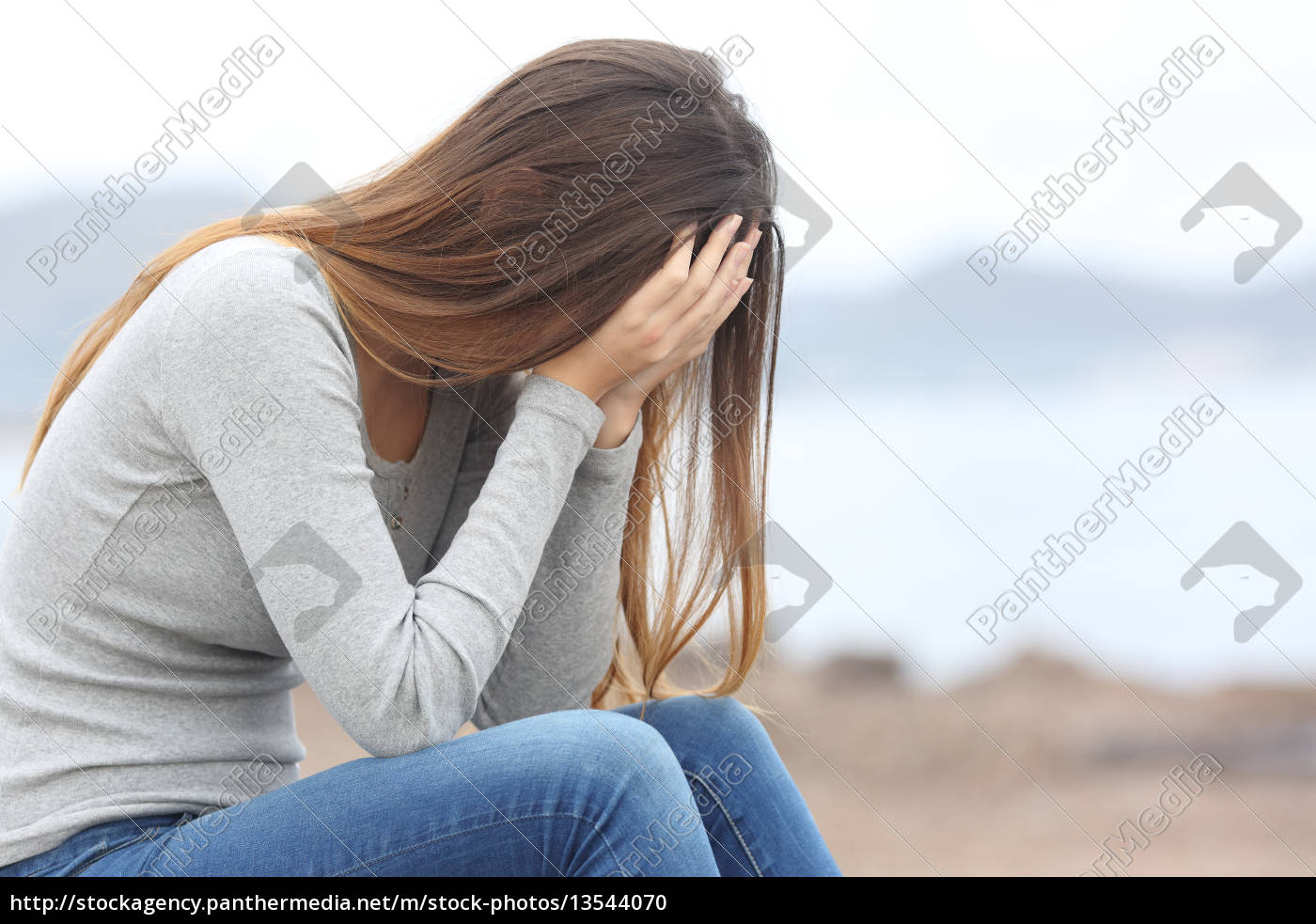 worried, teenager, woman, on, the, beach - 13544070