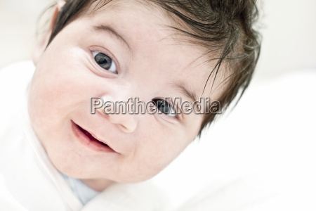 face of happy baby smiling happiness