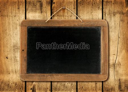 blackboard, on, a, wood, wall, background - 13554678