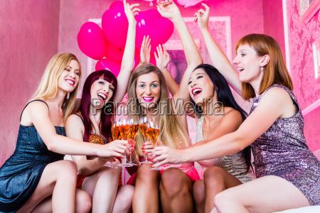 women celebrate in the nightclub