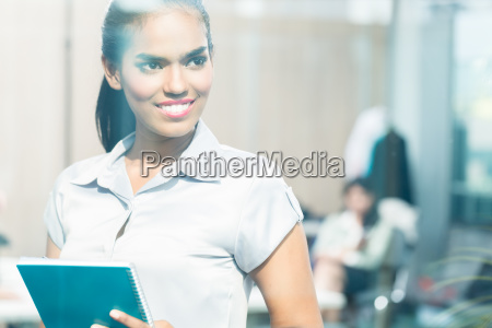 indian business woman looking through window