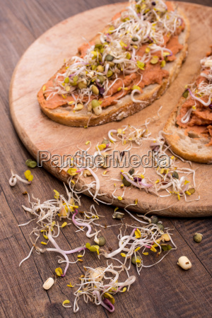 raw sprouts and bread with spread