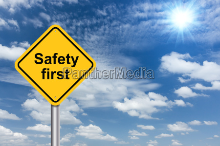safety first sign banner and clouds