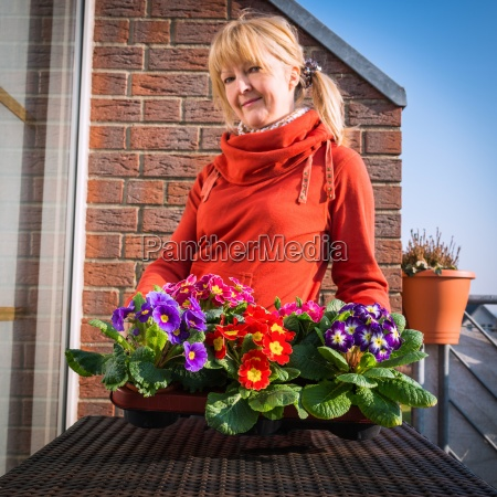 woman with primroses
