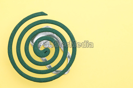 green mosquito spiral on yellow background