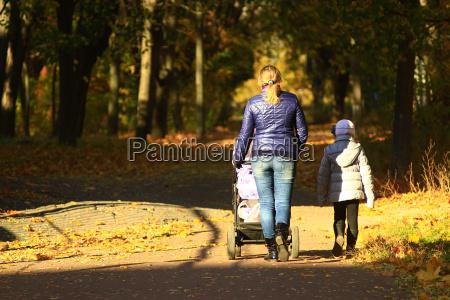 woman with perambulator and elder child