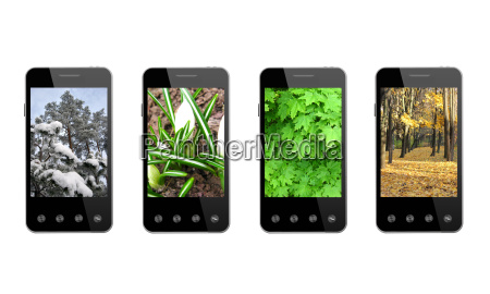 four smart phones with colored images