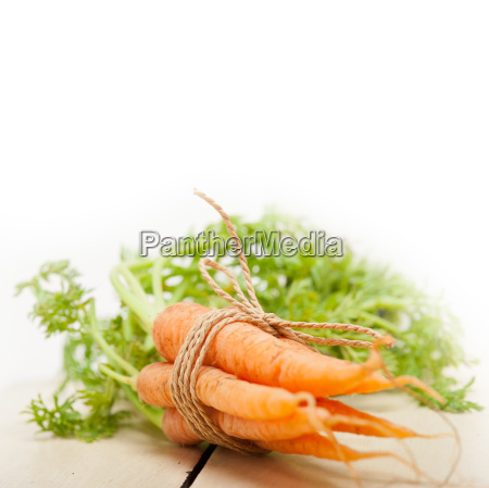 baby carrots bunch tied with rope