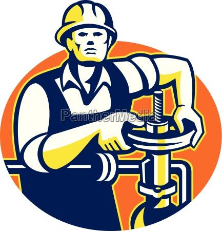 pipefitter oil worker tighten pipe valve