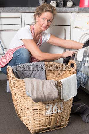 woman washing machine loads