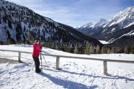 female photographer takes pictures in wintry