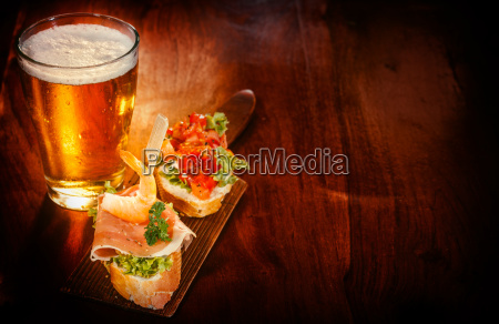 glass of beer with delicious tapas